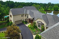 HOME OF THE DAY!  One of a kind, custom estate on five acres with gorgeous views of pastures, lake & pool. Stately brick & stone exterior, 7 garage bays, gourmet kitchen, in-law suite demonstrate expert craftsmanship & detail throughout; abundance of windows, sprawling terrace, covered patio, screened in porch & stately pool unite indoor & outdoor living with effortless harmony! Convenient location/private setting! CLICK ON THE LINK TO SEE MORE…