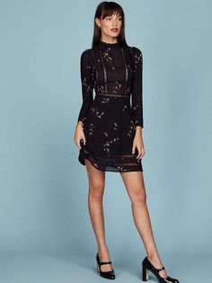Romance yourself. This is a long sleeve, fit and flare dress with lace trim detail and a high neck.
