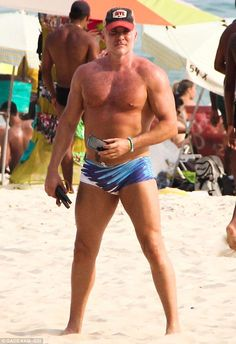 Catching some rays: Good Morning America weather anchor Sam Champion soaks up the sun at Ipanema Beach in Rio de Janeiro
