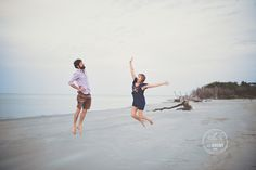 Couple jumping in the air during their engagement session on Folly Beach. Charleston engagement photography by @billiejojeremy.  #engagementphotographers #charleston #husbandandwife #photographers #charlestonengagements #follybeach #liveauthentic #vsco