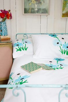 baby blue wrought iron bed w/ blue flowers on the sheets. Painted Iron Beds, Painted Metal, Turquoise Cottage, Floral Bedspread, Headboards For Beds, Home Bedroom, Cottage Bedrooms, Cottage Living, Master Bedroom