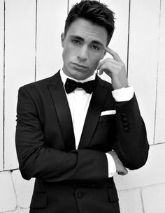 Colton Haynes in a black suit, white custom dress shirt and black bow tie. Classic look.