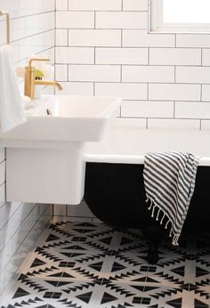 Now that I see it w/ the subway tiles, not sure I like it so much anymore --Capree Kimball's dramatic black and white bathroom renovation features 'Tulum' cement tile from The Cement Tile Shop Bad Inspiration, Bathroom Inspiration, Morning Inspiration, Black White Bathrooms, Black Tub, Bathroom Black, Small Bathrooms, Bathroom Tiling, Master Bathroom