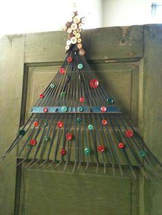 Old metal rake decorated like Christmas tree. Genious!