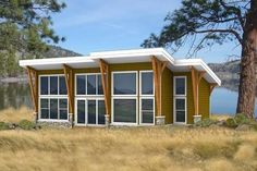 Large windows across front of cabin plan is perfect for views and sunlight. 2 bedrooms and modern style in 875 sq ft.