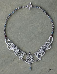 (2006) 18 length from end to end. Silver Art Clay, liver of sulphur, faceted labradorite beads, round garnet beads, 22 and 20 gauge silver wire, Bali silver, silver findings and silver beads, fireline.