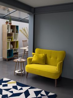 Dark Grey wall and yellow sofa, love