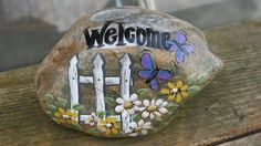 A Steine bemalen Painted Welcome rock with picket fence daisies by MyPaintedSwan Boost Your Confiden Rock Painting Patterns, Rock Painting Ideas Easy, Rock Painting Designs, Painting For Kids, Pebble Painting, Pebble Art, Stone Painting, Painting Walls, Stone Crafts