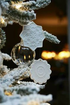 make white clay ornaments and press a doily in them