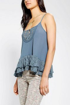Super swingy tank top from Kimchi Blue with a ruffled, tiered lace hem and a lace inset along the bib-style front.  Topped with a keyhole cu...