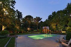 landscape uplighting making the yard look larger Surrounds Landscaping