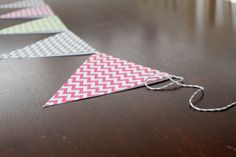 Making your own Paper Bunting is easy and affordable! This DIY tutorial will teach you how!