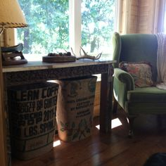 trashcans covered  with a burlap coffee beans bag!