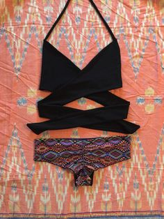 Boho chic Wrap Party bikini top in Classic Black and Bender scrunch butt bottoms in Azteca. The ultimate lounge-in-a-hammock, braid your hair