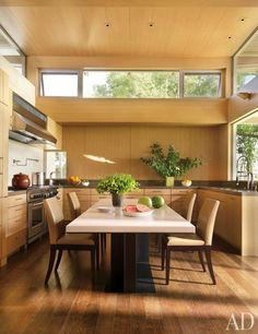 White-oak cabinetry lends a warm feel to the kitchen of a hillside home in Austin, Texas.