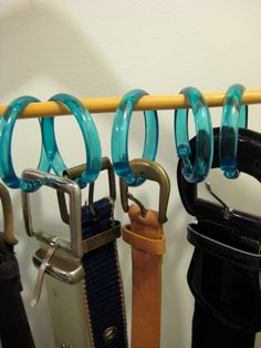 WOW.  It's that simple.  A storage solution I've been needing for belts! - I'm not sure I'd use this particular type of shower rings, but it's a clever idea.