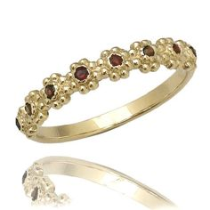 This is a lovely vintage inspired, flower Garnet 14k gold engagement band. The band features 17 shimmering garnets embedded in a delicate bead
