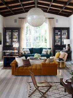 Nate Berkus | Rustic living room with statement velvet sofas #livingroomfurnituresets #modernsofas