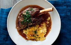 Cooking lamb shanks uncovered in their broth simultaneously browns and braises them, adding richness and color.