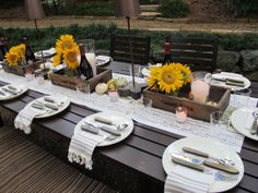 outdoor party - great napkin & silverware placement along with the runner and sunflowers.
