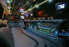 I just love all of the crazy colors in this limo! I've never been in a limo before, but I really want to go in one someday! Perhaps I can find a good excuse to ride in one soon!---Arrow Limousine and Sedan Services LTD - Red Deer