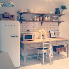 rustic kitchen with scaffolding board shelves More