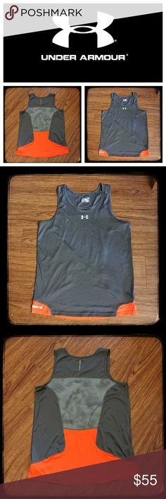 """Under Armour men's regular fit heatgear tank 📦Same day shipping (as long as P.O. is open for business). ❤ Measurements are approximate. Descriptions are accurate to the best of my knowledge.  Stay cool in this moisture wicking heatgear sleeveless top from Under Armour. It is regular fit in a cool charcoal gray with bright orange accents. Material tag has been removed but it is the synthetic moisture wicking material. Measurements: 20"""" across chest, 28.5"""" long. See last photo for 2 tiny…"""