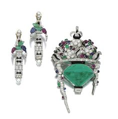GEM-SET AND DIAMOND BROOCH/PENDANT AND PAIR OF EARRINGS Comprising: a pendant/brooch of giardinetto design, set with a cabochon emerald, accented with similarly cut emeralds, sapphires and rubies, highlighted with circular-, single-cut and baguette diamonds, further decorated with black enamel, French import marks, together with a pair of earrings  ensuite.