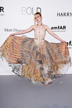 Elle Fanning arrives at amfAR's 23rd Cinema Against AIDS Gala at Hotel du Cap-Eden-Roc on May 19, 2016 in Cap d'Antibes, France.