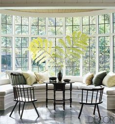 I have always wanted to have a bay window in my home with a bench seat because you can sit right up against the glass and feel as if you're outside with the view. Having a large bay window allows you to feel as if you're part of the exterior world, but it also gives you easy access to privacy by closing the shades.