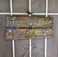 Repurposed old wood into front door sign with a quote from myself