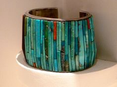 Mosaic Inlay bracelet by Charles Loloma, Hopi The feel of the weight on the wrist would help to center a person.