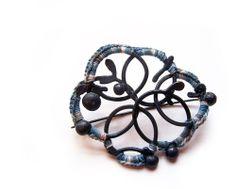 Joanne Haywood Neckpiece: Roman Brooch, indigo 2009 Hand dyed crocheted cotton and oxidised silver 6 x 5 x 1 cm approx