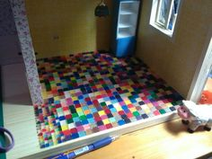 A floor in the kitchen - mosaic, meanwhile without mortar pointing.