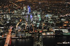 Looking past the spire of The Shard, across the Thames to the City and beyond