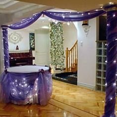 Twinkle lights and tulle -- really cute, might have to steal this idea for a certain person's bridal shower :)
