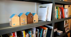 BERG Cloud + Twitter = #FLOCK, a wirelessly connected clock that reacts to the activity of an individual Twitter account.    #FLOCK is a set of four houses. Three contain colorful birds that react to Twitter triggers: a new follower, a retweet, or an @message will prompt the birds to pop out of the houses, each in a different way. The fourth house is a simple clock.