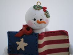 Polymer clay Snowman Christmas Ornament holding by HelensClayArt, $14.95