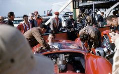 SEBRING 1958- Peter Collins sits in winning Ferrari P Hill, D. McCluggage behind