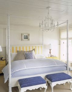 soft color palette...and look at that striped headboard! love it!