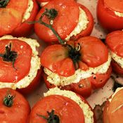 Oven-Roasted Tomatoes Stuffed with Goat Cheese, Recipe from Cooking.com.   Mmmm....feeds my obsession with goat cheese.