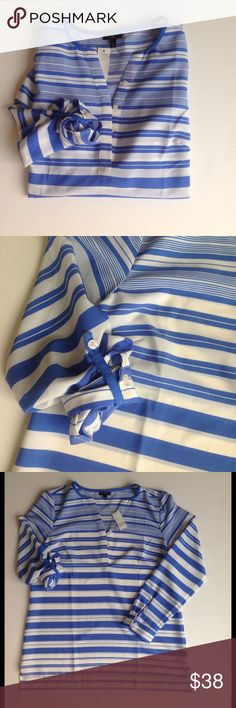 """NWT Talbots Variegated Blue and White Top Stunning blue and white variegated stripe top. NWT. Optional rolled sleeve with cobalt tab. Dress up or down - would look amazing with white jeans. 100% polyester. Flat measurements- 19"""" under arm, 24"""" length, 26"""" length in back, 22"""" sleeve. Talbots Tops Blouses"""