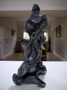 One of my first pieces - made from lead sheet worked into a 3D shape. Loosely based on a gnarled tree but you can see all sorts of shapes in the finished form.