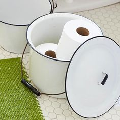 In the Bin: It's always important to keep extra rolls of bath tissue on hand, but storing them can be a nightmare. Here, a pair of metal buckets provide the perfect stowaway solution for the unsightly necessities. It's a budget-friendly solution that ensures your bathroom is always well-equipped.