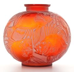 From The Estate Of A Prominent Lalique Collector. R. Lalique. 'Poissons' vase in cased red glass with white patina, circa 1921