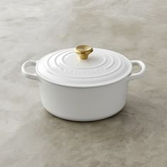 Is it a little odd how much more I love this dutch oven with a gold knob? Le Creuset Signature Cast-Iron Dutch Oven with Gold Knob from Williams Sonoma