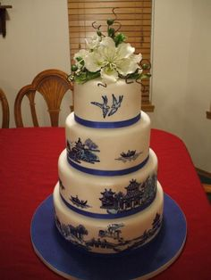Blue Willow - I won 1st place in the Kansas State Fair with this cake, the theme was china patterns. I painted the pattern, freehanded, with food coloring and the top is gumpaste flowers. This was the first time ive painted anything, I so happy with the finished cake.