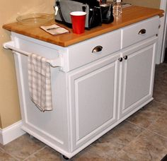 Great picture example of the rolling kitchen island with pull out trash/recycling, bottom molding & granite counter that I will be building!