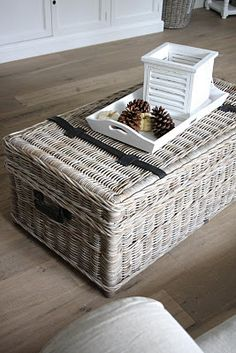 Wicker goes in almost any style of decor.  It is not custom, but it is so versatile.  Here it is both storage and coffee table.
