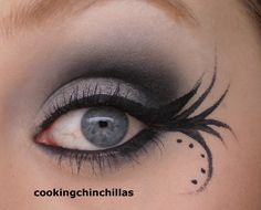 fun winging eyeliner with silver eyes